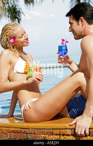 couple in love have fun at pool - Stock Photo