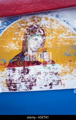 Religious painting on side of fishing boat - Stock Photo