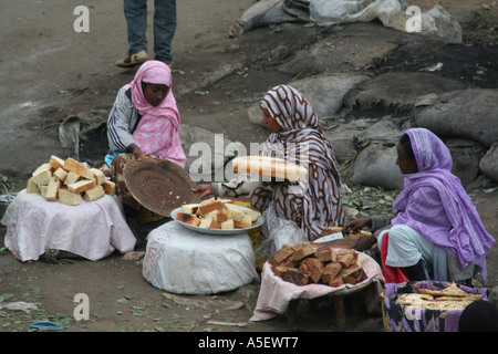 Harar, Ethiopia, women selling bread and cakes in the market - Stock Photo