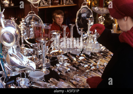 Silverware and home decorative objects for sale in a shop at Notting Hill Gate London - Stock Photo