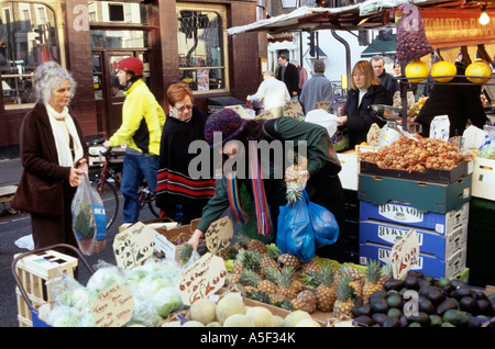 Shoppers in the street market at Notting Hill Gate London - Stock Photo