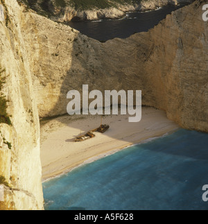 Spectacular sand beach and cove of Shipwreck Bay, tranquil in late afternoon on the west coast of Zakynthos Island - Stock Photo
