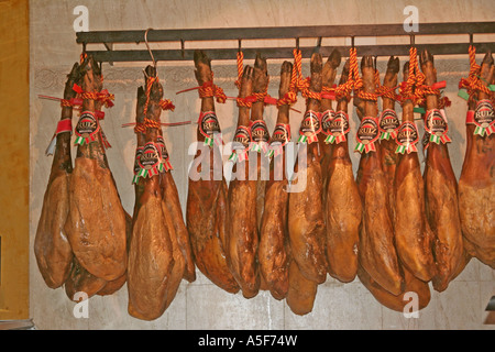 ham legs jamon iberico Ruiz hanging in a cafe at Seville Andalucia Spain - Stock Photo