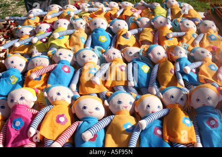 many rag dolls on display at a market - Stock Photo