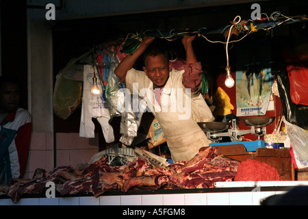 Butcher selling meat at Analakely market pavilion in Antananarivo, Madagascar - Stock Photo