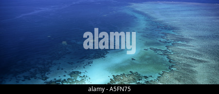 A panoramic aerial photograph of the clear blue waters of the Great Barrier Reef Australia credit JR Marshall - Stock Photo
