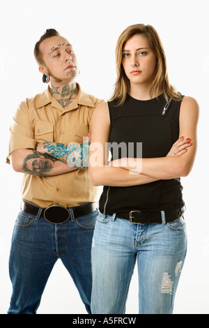 Caucasian mid adult man looking at teen female who is looking away - Stock Photo