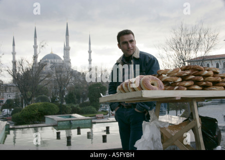 SIMIT PASTRY SELLER IN FRONT OF THE BLUE MOSQUE, ISTANBUL, TURKEY - Stock Photo