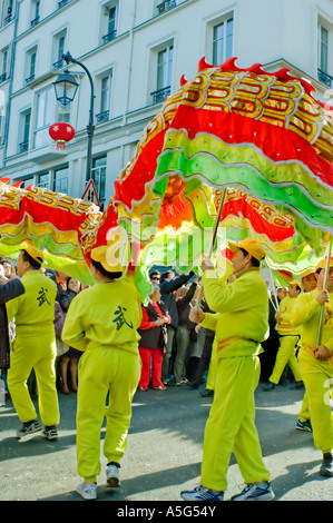Paris France Street Scene French Chinese in Traditional Costumes Parading 'Chinese Dragon Dance' in 'Chinese new - Stock Photo