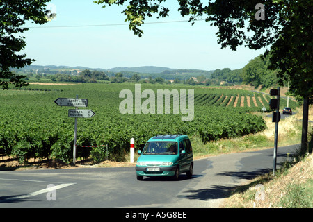 Green Car Driving through vineyards in the Ventenac Minervois area Languedoc Roussillon Southern France - Stock Photo