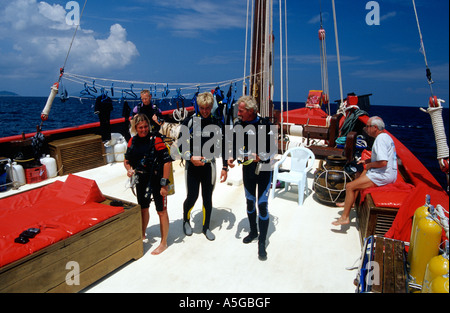 Scuba divers getting ready on board The Junk a converted Chinese junk dive boat the Similans Thailand Andaman Sea - Stock Photo