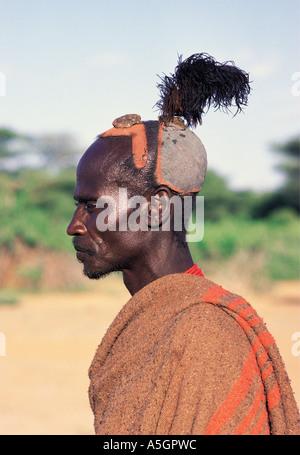 Portrait of Turkana married man with blue clay hairdo Kenya East Africa - Stock Photo