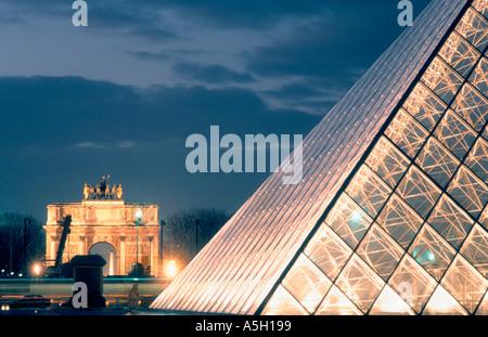 Paris France, 'I.M. Pei' Pyramid at the Louvre Museum with 'Arc de Triomphe du Carrousel' Architect, Lit Up, Night - Stock Photo