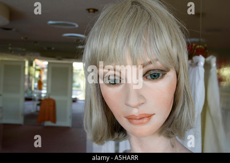 Closeup portrait of a rather haunting female mannequin in a women's clothing store. Camera: Nikon D2x. - Stock Photo