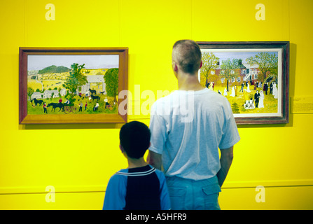 Primitive American style paintings by artist Grandma Moses in the Bennington Museum, Vermont, New England, USA - Stock Photo