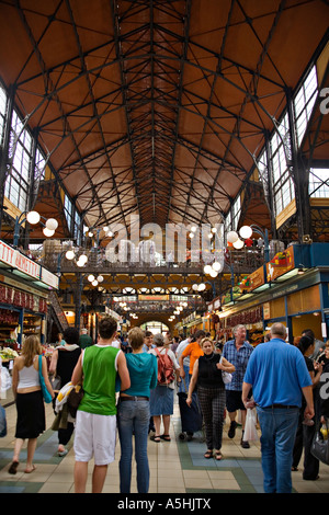 HUNGARY Budapest Main aisle crowded with people in interior of Nagycsarnok market - Stock Photo