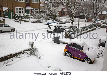 Electric powered car after heavy snow fall, Muswell Hill, London England - Stock Photo