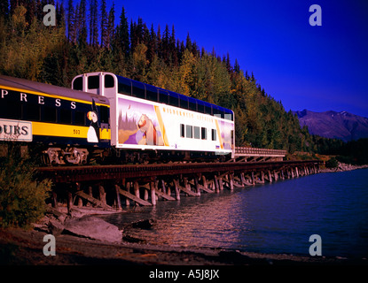 The Alaska Railroad and RCCL Wilderness Express, crossing the Lower Trail Lake trestle on its way to Seward - Stock Photo