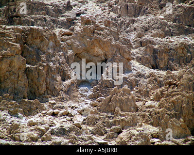 Entrance to one of the Qumran caves - Stock Photo