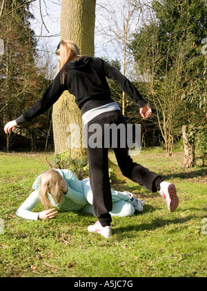 girls outside fighting - Stock Photo