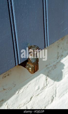 Cast head on window shutter stay St Valery France - Stock Photo