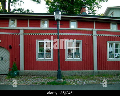 red wooden house in old town of Naantali in the southwestern coast of Finland - Stock Photo
