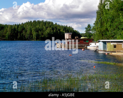 lake distrikt middle Finland lake Saimaa boats on the lakefront old house boats - Stock Photo