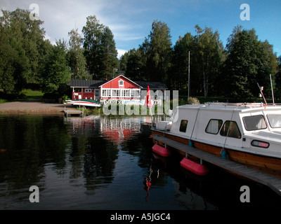 lake distrikt middle Finland lake Saimaa boats on the lakefront - Stock Photo