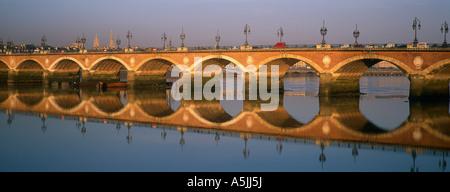 Pont de Pierre (stone bridge) over the Garonne river, Bordeaux. Gironde, Aquitaine, France - Stock Photo