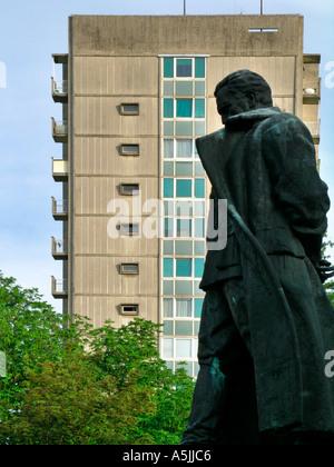 sculpture of Josip Broz Tito vor plattenbau buillding in Velenje in Slovenia - Stock Photo
