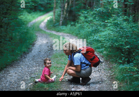 A mother and daughter explore an old woods road in Vermont s Northeast Kingdom  - Stock Photo