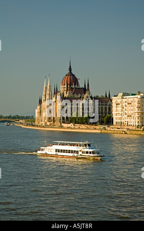 View to Budapest and the Government Building view from Chain Bridge, Riverboat in front of the Government Building, - Stock Photo