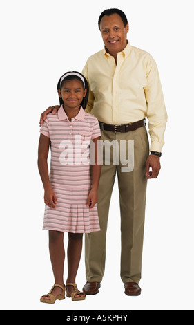 Studio shot of father with arm around daughter - Stock Photo