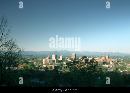 A shot of downtown Asheville North Carolina on a clear summer day The city is nestled in the mountains  - Stock Photo