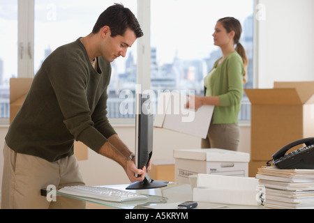 Businesspeople setting up new office - Stock Photo