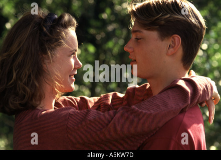 Teenage couple lovingly looking at each other - Stock Photo