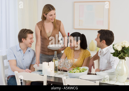 Two couples having dinner party - Stock Photo