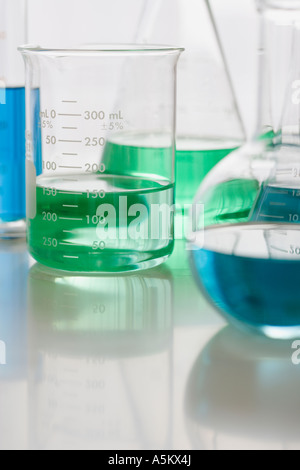 Close up of beakers with liquid - Stock Photo