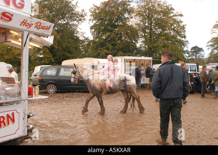 Riding bareback in the mud at the Stow Horse Fair, Stow On The Wold, Gloucestershire, UK - Stock Photo
