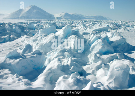View across frozen sea showing large chunks of ice forced upwards by pressure from colliding ice sheets, Canadian - Stock Photo
