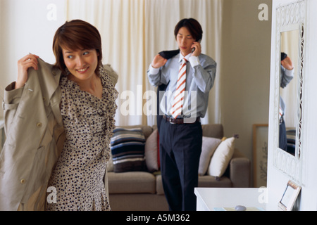 Asian couple getting ready to leave - Stock Photo