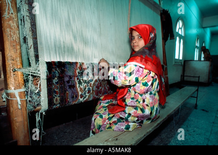 Saqqhrah, Egypt, Young Female Child Working in Carpet Factory Child Labor, Working Conditions, Schools from around - Stock Photo