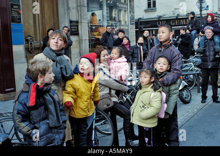 Paris France 'Chinese French' Families Celebrating 'Chinese New Year' on 'Street Festival' 'Parents with Kids Outside' - Stock Photo