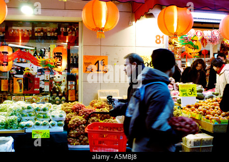 Paris France Chinese Supermarket  Outside in Chinatown 'The Big Store' 'Lit up' Night People Shopping Front - Stock Photo