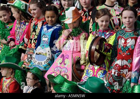 Children wearing patriotic costumes for St Patrick s Day celebrations in Birmingham UK - Stock Photo