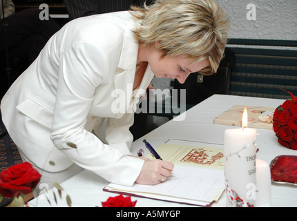 bride signing wedding contract Stock Photo