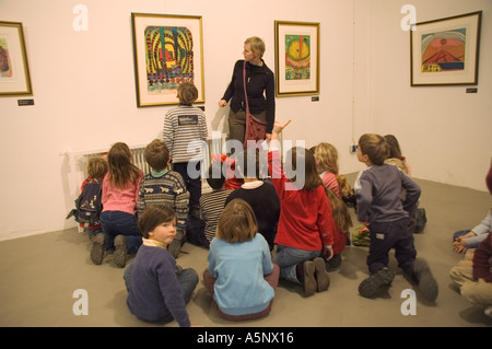 pupils of a 2nd class in primary school guided through a Friedensreich Hundertwasser exhibition - Stock Photo