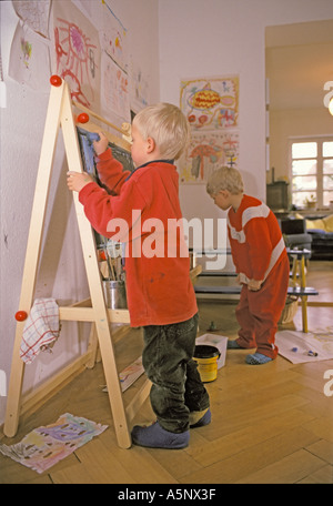Five year old boy painting - Stock Photo