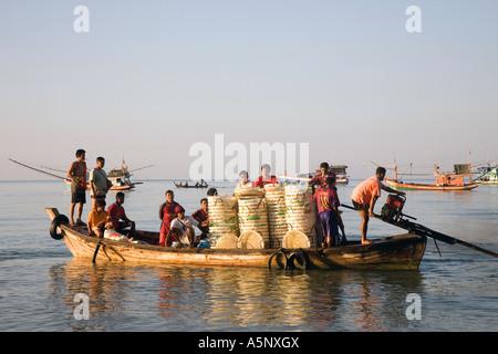 Fishing Boats, fishermen, seashore, workers, sea coast fishing, loaded boat, crew returning with catch at dawn Krabi - Stock Photo