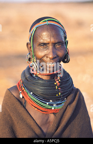 Rendille grandmother wearing traditional necklace made from bundles of giraffe tail hair Korr northern Kenya East - Stock Photo